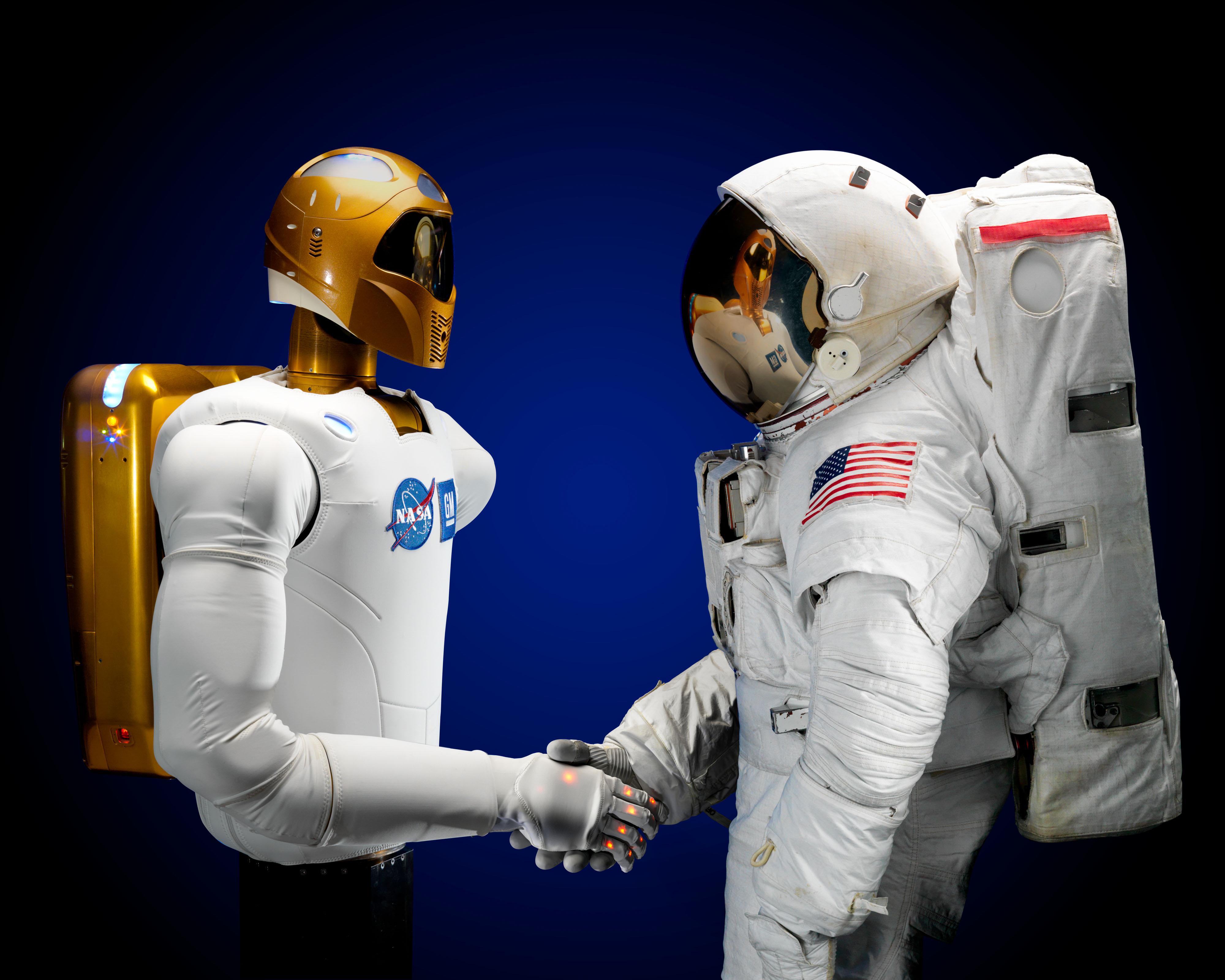 Robonaut_and_astronaut_hand_shake